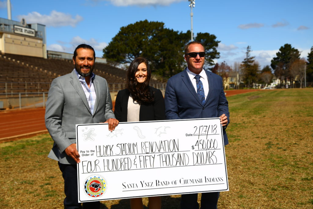 Kenneth Kahn, Santa Ynez Band of Chumash Indians Tribal Chairman, presents major gift of $450,000 to Ashley Costa, Campaign Co-Chair and to Trevor McDonald, Lompoc Unified School District Superintendent.