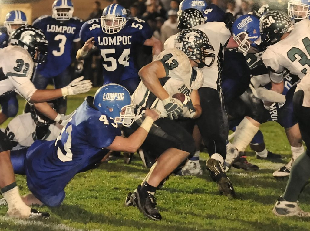 "This picture known as ""The Tackle"" was a game-saving stop that secured a CIF championship at Huyck Stadium in 2010. With seconds remaining, Joe Valla (3rd generation Brave) made the tackle on the 1 yard line as time ran out, giving the Braves championship number 4!"