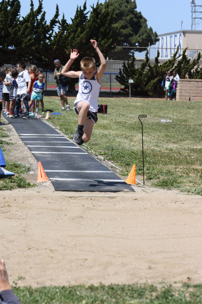 Wyatt Bohard representing the Central Coast All-Stars Track Club in the Long Jump at the 2016 Lompoc Kiwanis Track Meet. Photo submitted by Kari Campbell-Bohard.